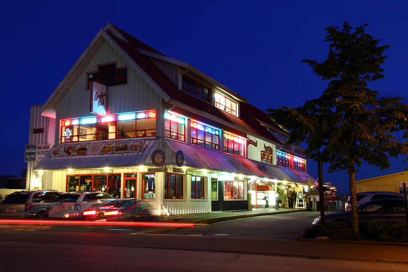 The building that houses the Blue Canoe and Charthouse restaurants in Steveston Village. Photo taken at twilight.