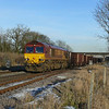 66148 gets to grips with its train 6T251320 Immingham F.O.T. - Santon F.O.T. loaded Iron Ore tipplers at Brockelsby Junction.