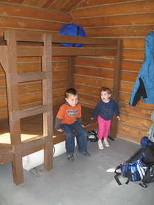 Trying out the bed platforms at the Upper Ohmer Lake public use cabin.