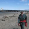Stormy Mohn walking along the beach in Bandon, Oregon.