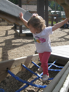 At the playground in Girdwood.  Hilary negociates the rope climb.