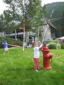 Hilary likes making the wand on the fire hydrant flip back and forth.