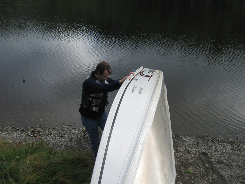 Paul readys the rowboat for a lake row.  The cabin comes equipped with life preservers.