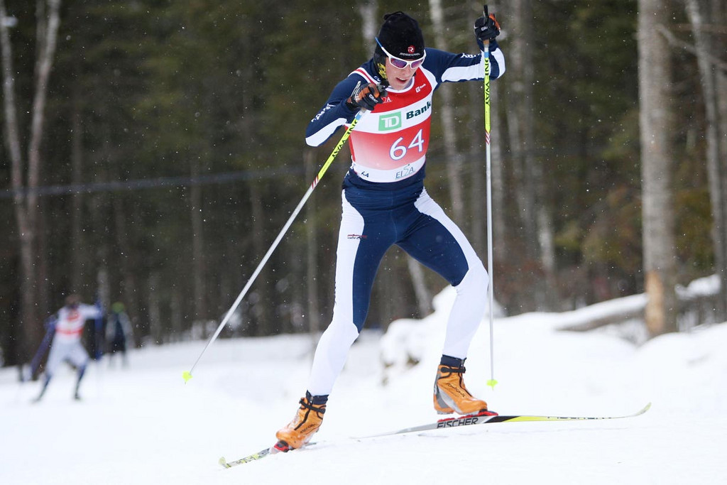 Middlebury's Patrick Johnson takes the win at the University of Vermont's 10k Skate event at their home carnival with Nordic events held at the Trapp Family Lodge.<br /> <br /> CREDIT: Lincoln Benedict / EISA