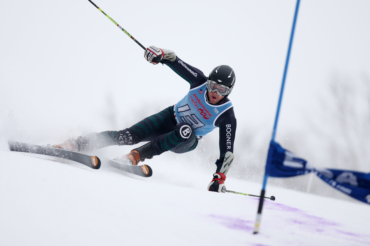 The University of Vermont's Chris Colpitts, en route to victory, battles to find an edge on his way down the Giant Slalom course at the 94th Williams Carnival Alpine races, held at Jiminy Peak in Hancock, MA.<br /> <br /> CREDIT: Lincoln Benedict / EISA