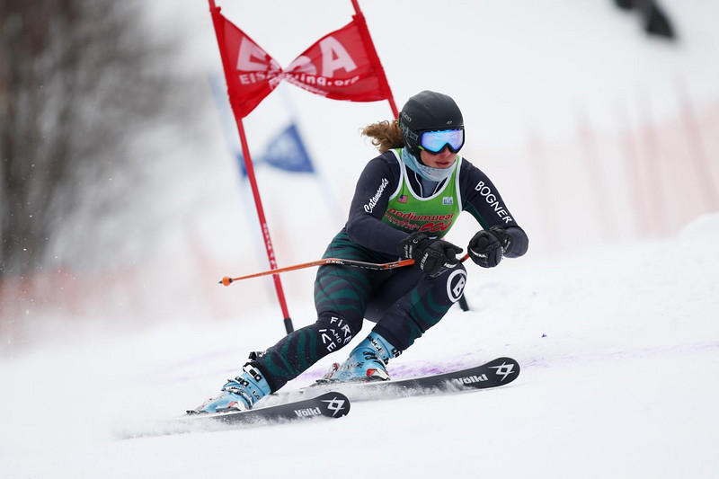 The University of Vermont's Valerie Kechian, en route to victory, tucks her way down the Giant Slalom course at the 94th Williams Carnival Alpine races, held at Jiminy Peak in Hancock, MA