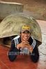 Ecuador : Turista posando en una concha de una tortuga gigante de Galapagos . / Tourist posing in a shell of a Galapagos giant tortoise. / Ekuador: Tourist posiert in einem Panzer einer Galapagos-Riesenschildkröte. © German Falke/LATINPHOTO.org