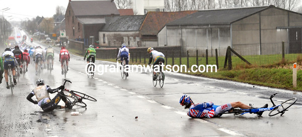 Two riders have hit the deck as the pace sends the peloton through patches of slick mud...