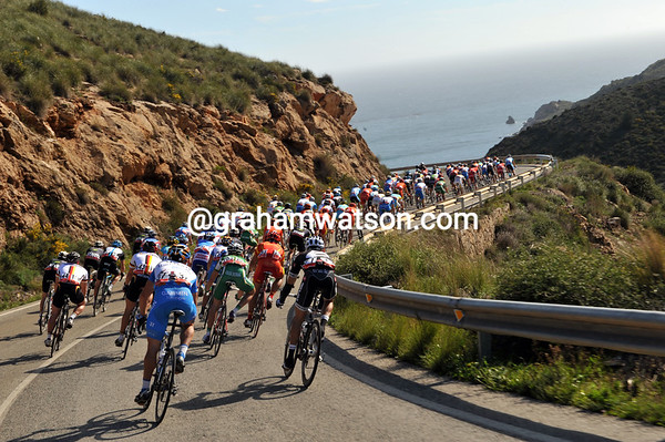 The peloton heads down to the sea on the Costa Calida, aware that it's getting windy out there...