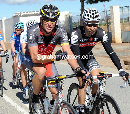 Happy old men - with their combined age of around 80 years, Lance Armstrong and Inigo Cuesta are talking pension-talk at the front of the peloton...