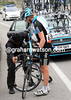 Lars Petter Nordhaug is off the pace for a while, making a messy wheel-change back down the road...