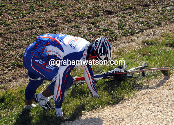 Napolitano goes down alone after touching wheels...