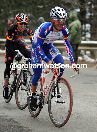 Joachin Rodriguez and Alejandro Valverde are the nearest chasers with one-kilometre left...