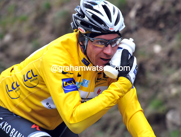 Hardman Jens Voigt uses a bottle of warm water to keep his face from freezing over...