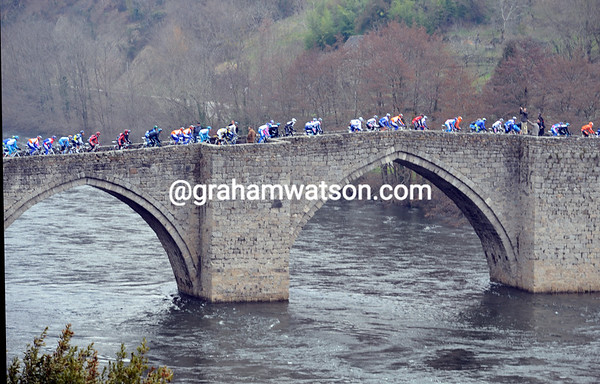 The peloton crosses the Lot river at Montsalvy - still five minutes down...