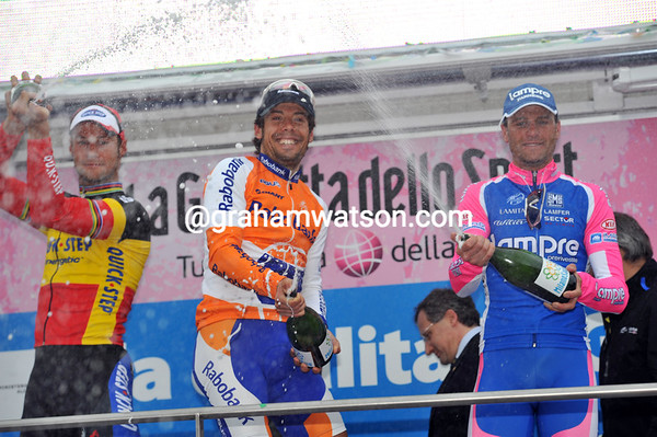 Oscar Freire celebrates with runner-up Tom Boonen and 3rd-placed Alessandro Petacchi...