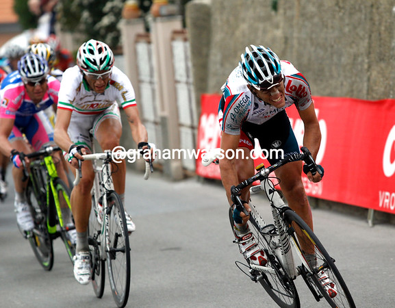 Philippe Gilbert makes the first move from the leading group - Pozzato and Petacchi are with him...