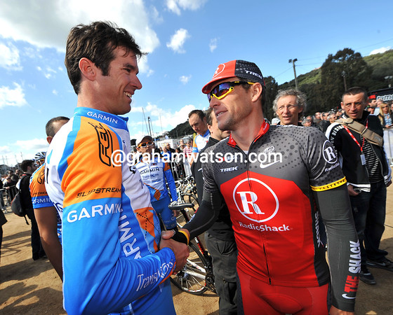 Lance Armstrong manages a few quiet words with his mate David Millar...