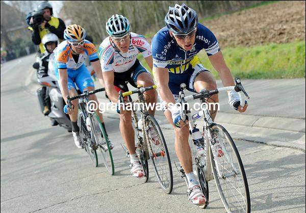 Millar has been caught by Bjorn Leukemans and Philippe Gilbert 10-kilometres from the Mur de Grammont...