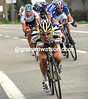 Eisel dips his shoulders and chases - Hincapie and Gilbert look concerned at maybe having missed the key move...