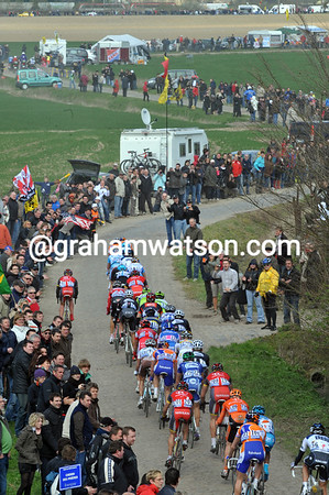 The cobbles at Orchies show a new situation - a leading group of about 35 riders...