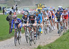 A nineteen-man escape is in front at the first cobbles - but only by two minutes...