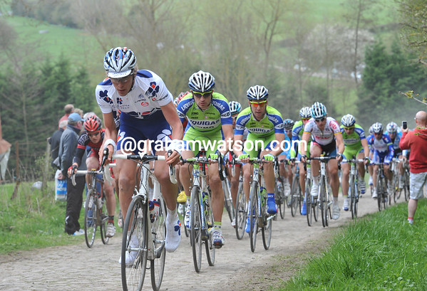 Francaise des Jeux starts to chase on the fifth section of cobbles...