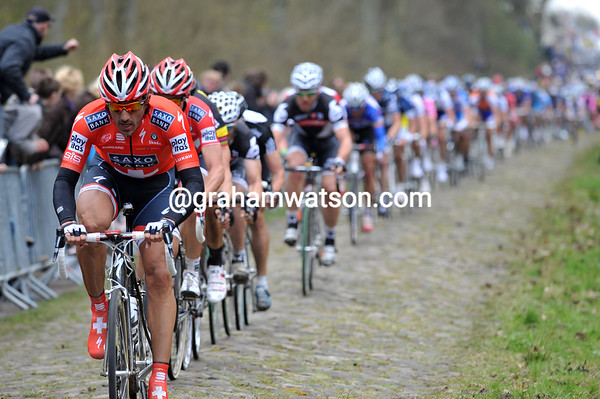 The man to watch - Fabian Cancellara leads the peloton into the Arenberg forest...