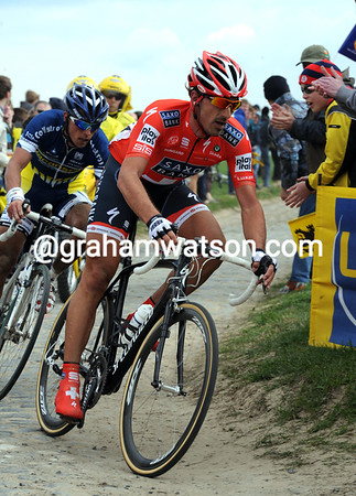 Fabian Cancellara is already pulling away at Mons-en-Pevele...