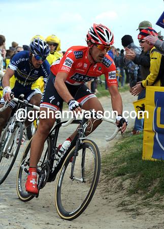 Fabian Cancellara is already pulling away at Mons-en-Pevele...