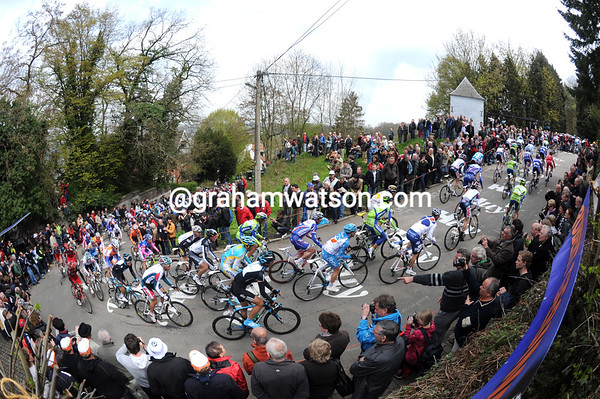 The peloton climbs the Mur de Huy for the first time of the day - they must climb it twice more...