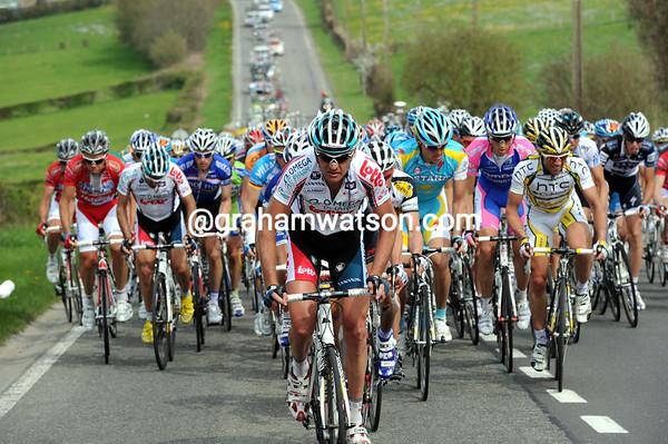 The peloton starts the Mont Theux 45-seconds down on the escape that has Monfort amongst them...