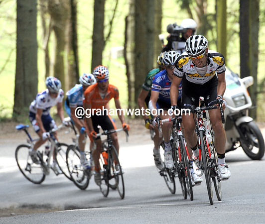 De Gendt leads the escape on to the forested Cote de Rosiers - they have five minutes lead still...