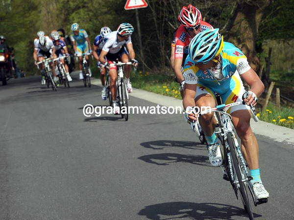 Contador is marking Evans at the back as Vinokourov makes an attack at the front...