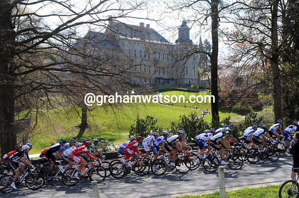 The peloton is in a long line as it passes a fine chateau in the Ardennes...