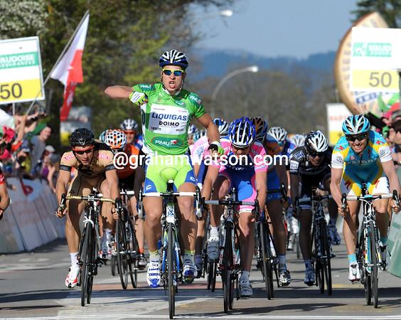 Peter Sagan wins stage one of the Tour de Romandie, ahead of Francesco sGavazzi and Nicholas Roche (out of shot)