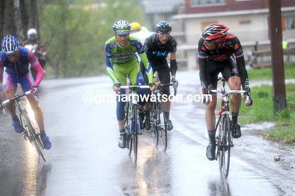 Spilak attacks with 10-kilometres to go, watched by Moreau...