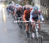 Mario Aerts leads the peloton in pursuit...