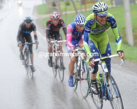The race has changed after the descent - Ivan Basso lead a quartet that also contains Spilak, Possoni and Moreau...