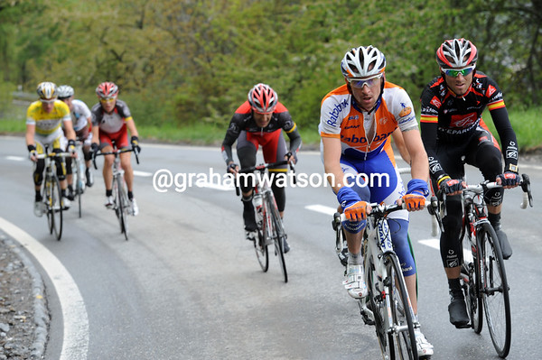 Denis Menchov applies the coup-de-grace for Rogers with five-kilometres of climbing left...