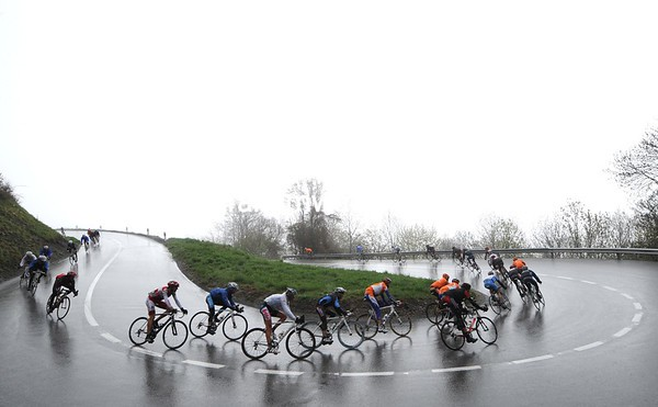 What's left of the peloton descends the second Col of the day in miserable conditions...