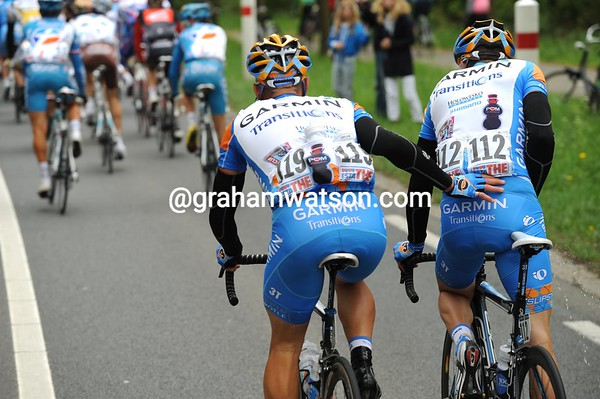 Teamwork - Svein Tuft lends a hand to Christian Vande Velde in a quiet moment...