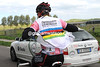 Dress sense: Evans puts a world champion's body warmer over his Maglia Rosa jersey - it's cold out there today...