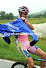 Vincenzo Nibali takes on his rain-jacket while the peloton relaxes...