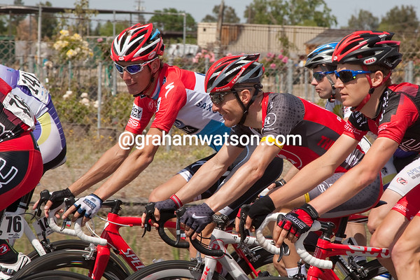 ...while Levi shares a joke with Andy Schleck.
