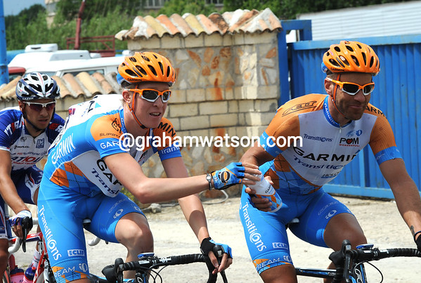 Serving his elders, Meyer hands a bottle to Svein Tuft, one of Tyler Farrar's lead-out men later today...