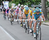 Astana seizes the chance to inflict further damage on Vinokourov's rivals - they mass at the front now...