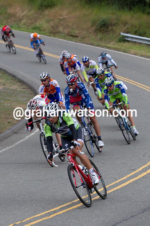 Haedo, wearing green because Cav can't wear two jerseys, descends a small hill after the feed zone.