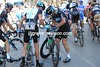 Henderson has crashed in a town 15-kilometres from the end, his Sky teamates stand by to help him get back...