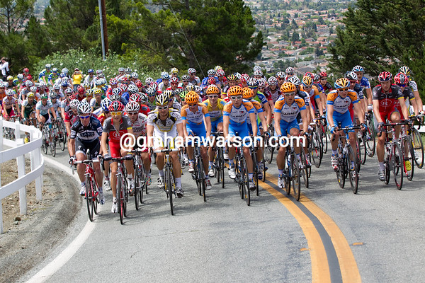 As the climb starts, the peloton is in perfect formation.